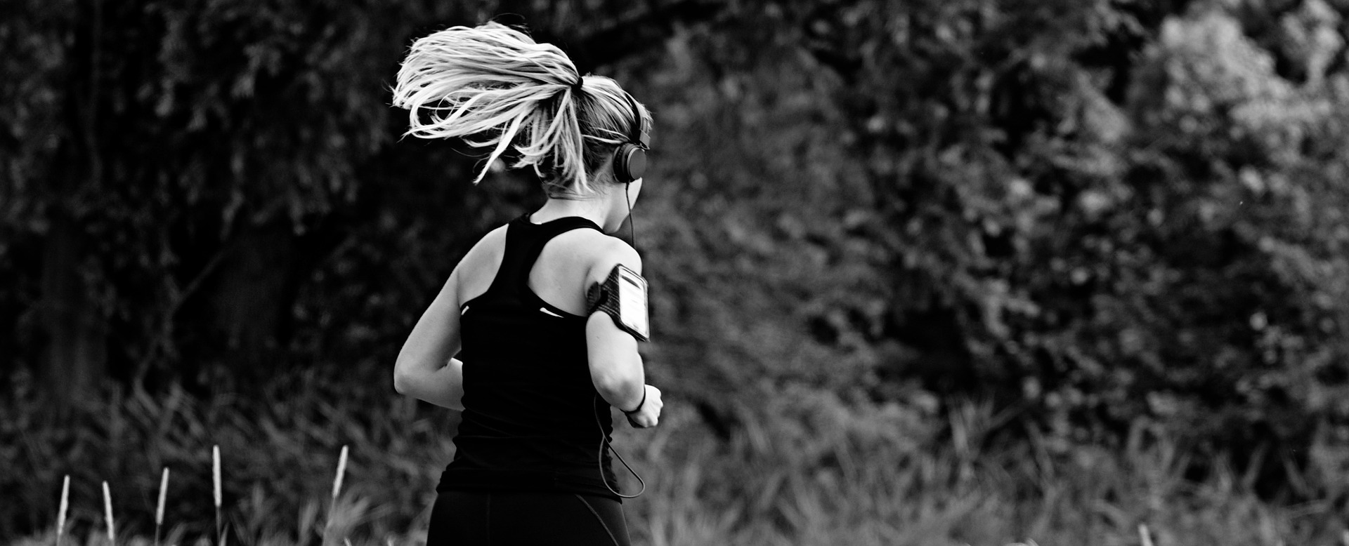 Woman running listening to her mobile device