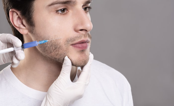 young man having beard growth injection