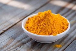 Turmeric powder in white cup