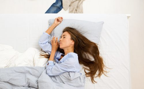 Young woman sleeping after taking zinc supplement