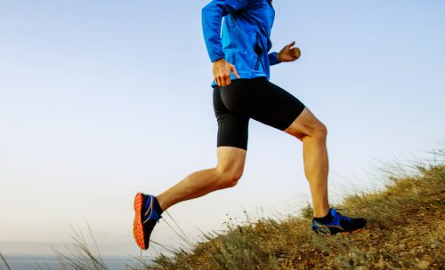 man running up hill for incline workout
