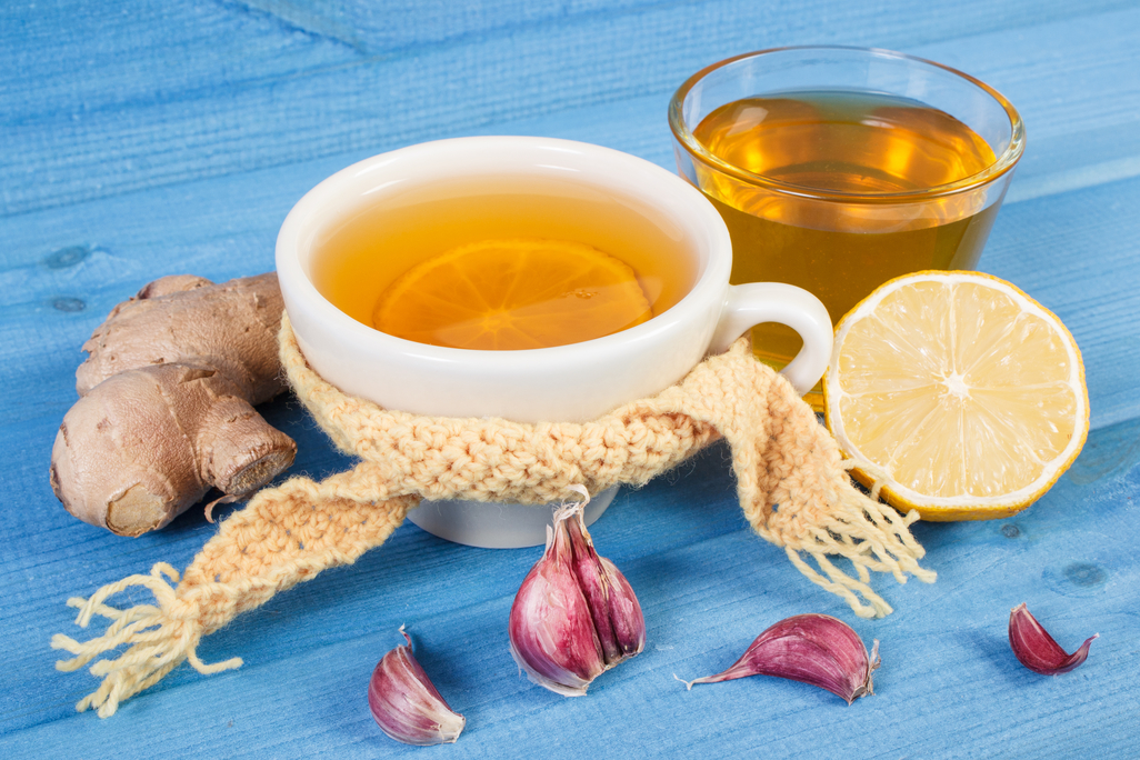 natural pain relief tea with ginger garlic and lemon