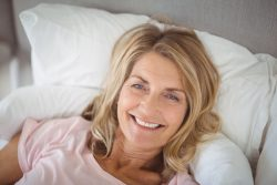 happy senior woman in bed