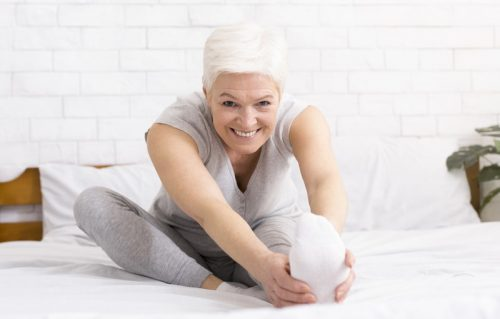 mature woman doing leg stretch exercise