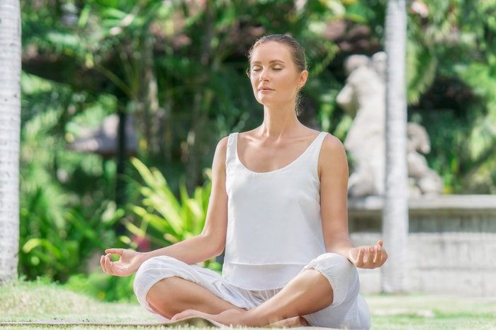 woman meditating to calm anxiety